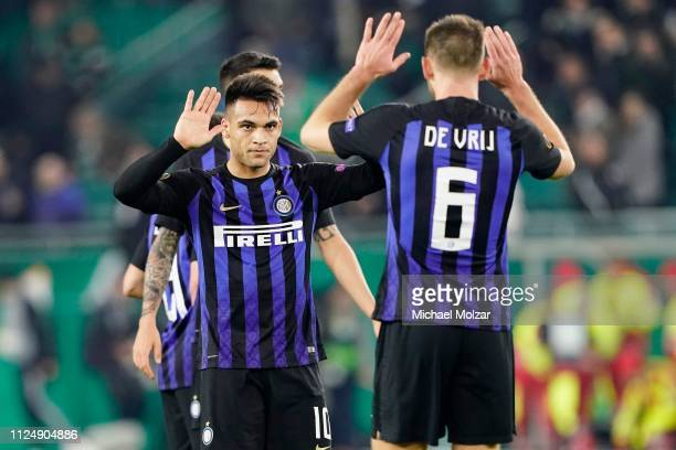 Lautaro Martinez of FC Internazionale and Stefan de Vrij of FC Internazionale are happy about the victory during the UEFA Europa League Round of 32...