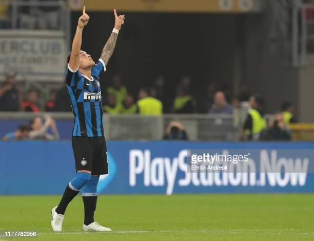 Lautaro Martinez of FC Internazionale celebrates after scoring the opening goal during the UEFA Champions League group F match between FC...