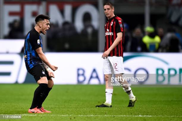 Lautaro Martinez of FC Internazionale celebrates the victory as Andrea Conti of AC Milan is dejected at the end of the Serie A football match between...