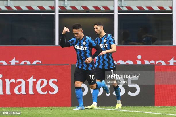 Lautaro Martinez of FC Internazionale celebrates with Achraf Hakimi after scoring his team's second goal during the Serie A match between AC Milan...