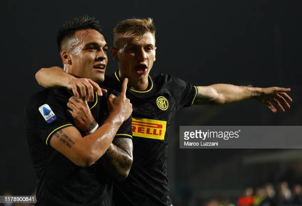 Lautaro Martinez of FC Internazionale celebrates with his teammate Nicolo Barella after scoring the opening goal during the Serie A match between...