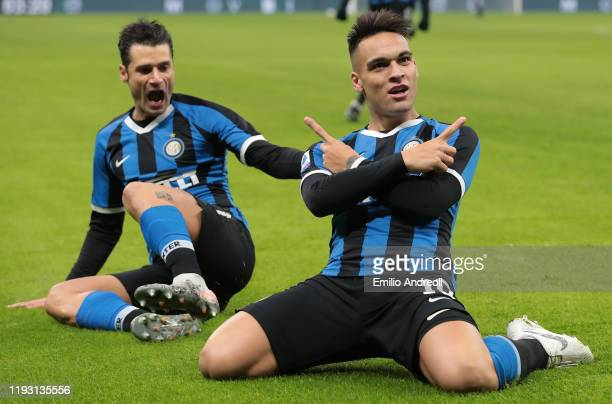 Lautaro Martinez of FC Internazionale celebrates with his teammate Antonio Candreva after scoring the opening goal during the Serie A match between...