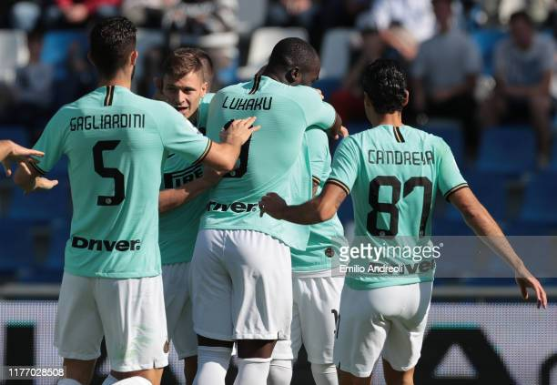Lautaro Martinez of FC Internazionale celebrates with his teammates after scoring the opening goal during the Serie A match between US Sassuolo and...