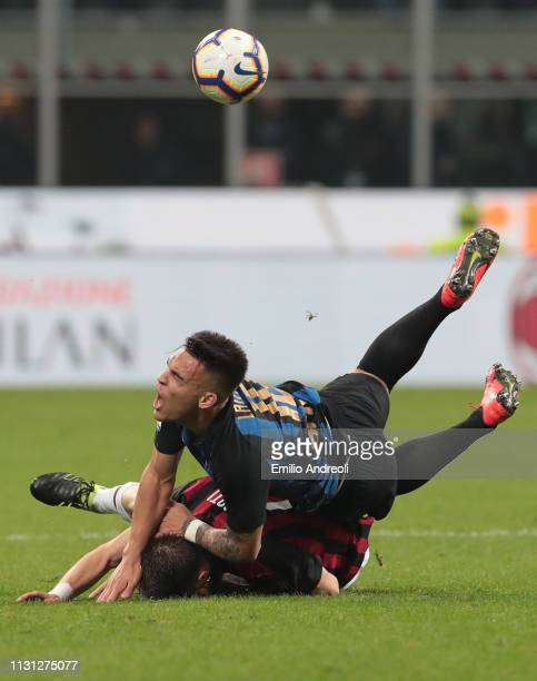 Lautaro Martinez of FC Internazionale competes for the ball with Andrea Conti of AC Milan during the Serie A match between AC Milan and FC...
