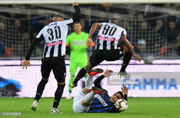 Lautaro Martinez of FC Internazionale competes for the ball with Marvin Zeegelaar of Udinese Calcio during the Serie A match between Udinese and FC...