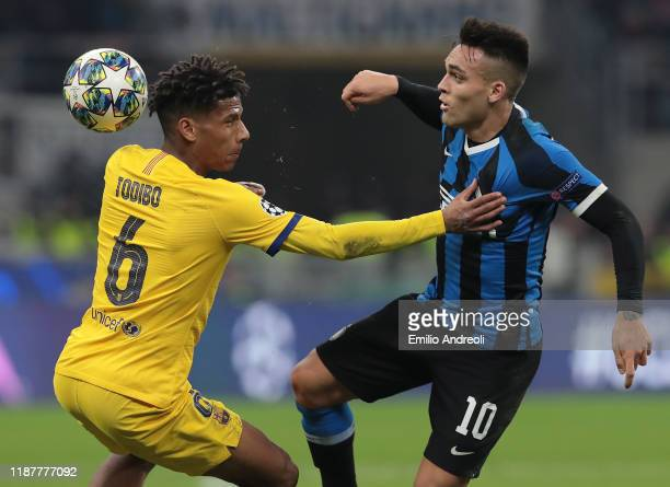 Lautaro Martinez of FC Internazionale competes for the ball with Jean-Clair Todibo of FC Barcelona during the UEFA Champions League group F match...