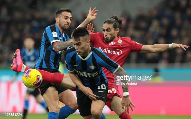 Lautaro Martinez of FC Internazionale competes for the ball with Martin Caceres of ACF Fiorentina during the Coppa Italia Quarter Final match between...
