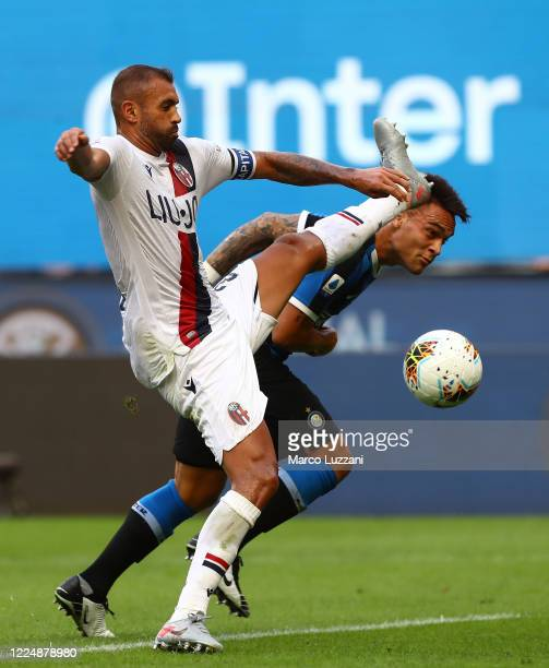 Lautaro Martinez of FC Internazionale competes for the ball with Danilo Larangeira of Bologna FC during the Serie A match between FC Internazionale...