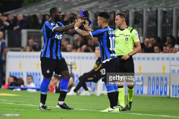 Lautaro Martinez of FC Internazionale greets teammate Romelu Lukaku as he substitutes him during the Serie A match between FC Internazionale and...