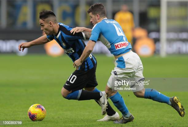 Lautaro Martinez of FC Internazionale is challenged by Diego Demme of SSC Napoli during the Coppa Italia Semi Final match between FC Internazionale...