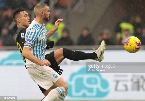 Lautaro Martinez of FC Internazionale is challenged by Francesco Vicari of Spal during the Serie A match between FC Internazionale and SPAL at Stadio...
