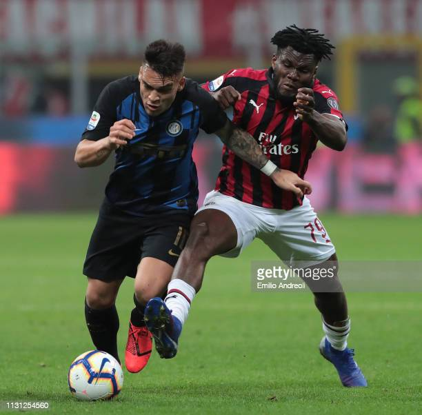 Lautaro Martinez of FC Internazionale is challenged by Frank Kessie of AC Milan during the Serie A match between AC Milan and FC Internazionale at...