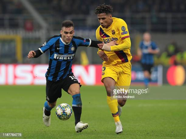 Lautaro Martinez of FC Internazionale is challenged by Jean-Clair Todibo of FC Barcelona during the UEFA Champions League group F match between FC...