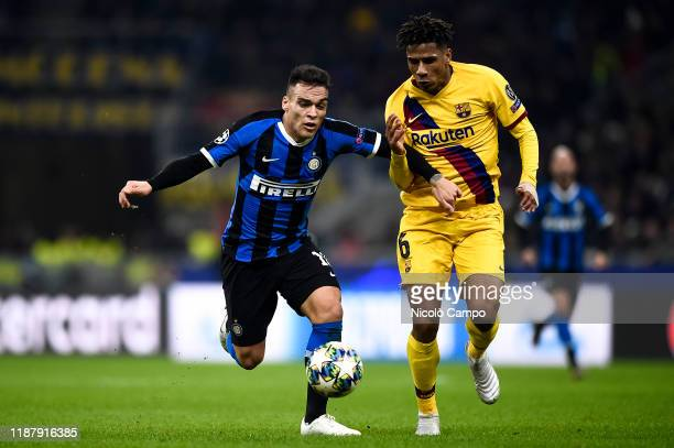 Lautaro Martinez of FC Internazionale is challenged by JeanClair Todibo of FC Barcelona during the UEFA Champions League football match between FC...