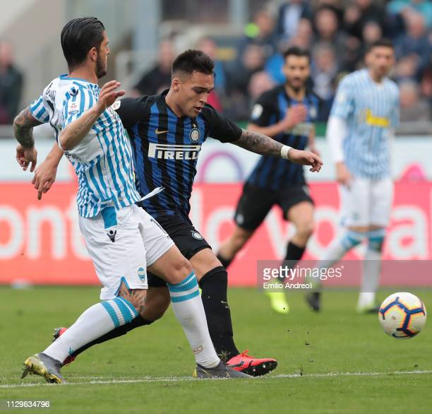 Lautaro Martinez of FC Internazionale is challenged by Kevin Bonifazi of Spal during the Serie A match between FC Internazionale and SPAL at Stadio...