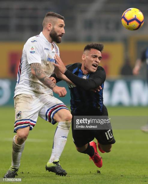 Lautaro Martinez of FC Internazionale is challenged by Lorenzo Tonelli of UC Sampdoria during the Serie A match between FC Internazionale and UC...
