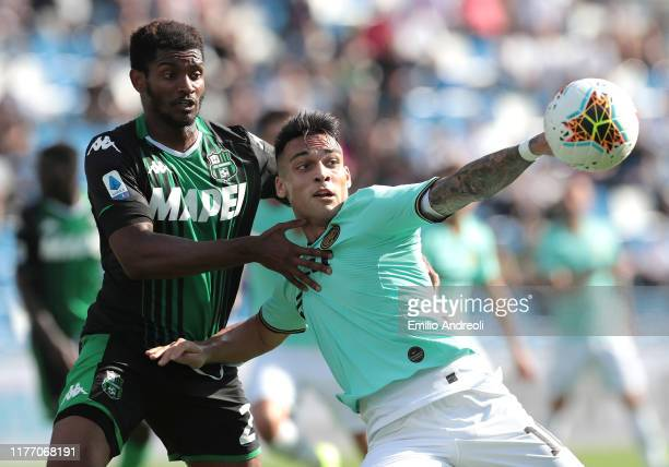 Lautaro Martinez of FC Internazionale is challenged by Marlon of US Sassuolo during the Serie A match between US Sassuolo and FC Internazionale at...