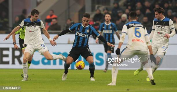 Lautaro Martinez of FC Internazionale is challenged by Marten De Roon of Atalanta BC during the Serie A match between FC Internazionale and Atalanta...