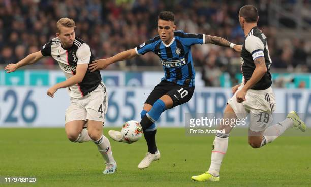 Lautaro Martinez of FC Internazionale is challenged by Matthijs de Ligt of Juventus during the Serie A match between FC Internazionale and Juventus...