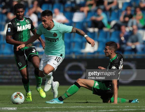 Lautaro Martinez of FC Internazionale is challenged by Mert Muldur of US Sassuolo during the Serie A match between US Sassuolo and FC Internazionale...