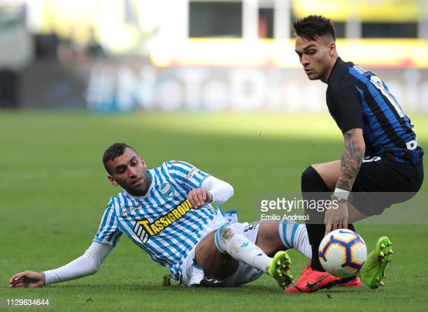 Lautaro Martinez of FC Internazionale is challenged by Mohamed Fares of Spal during the Serie A match between FC Internazionale and SPAL at Stadio...