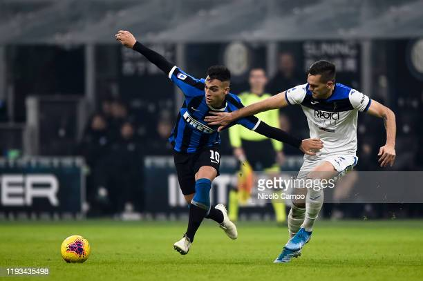 Lautaro Martinez of FC Internazionale is challenged by Rafael Toloi of Atalanta BC during the Serie A football match between FC Internazionale and...
