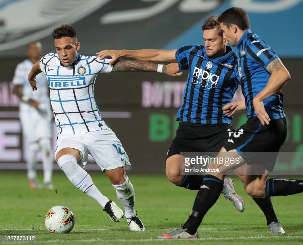 Lautaro Martinez of FC Internazionale is challenged by Rafael Toloi of Atalanta BC during the Serie A match between Atalanta BC and FC Internazionale...