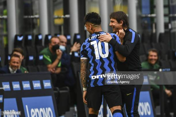 Lautaro Martinez of FC Internazionale is congratulated by head coach Antonio Conte during the Serie A match FC Internazionale and Udinese at the...