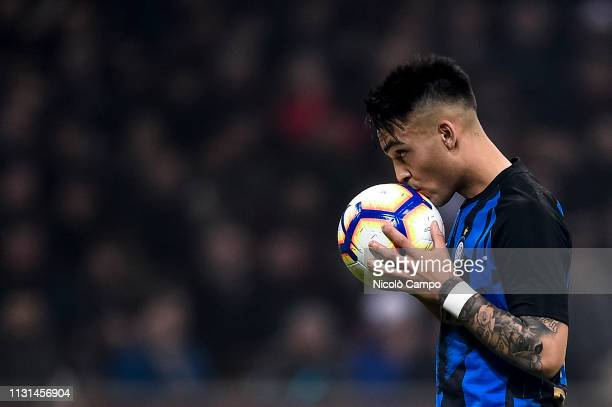 Lautaro Martinez of FC Internazionale kisses the ball during the Serie A football match between AC Milan and FC Internazionale FC Internazionale won...
