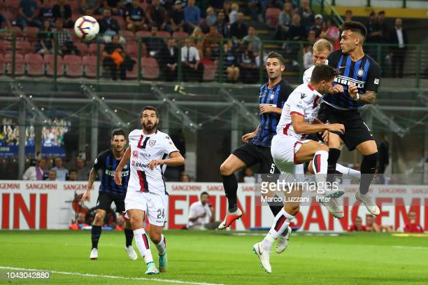 Lautaro Martinez of FC Internazionale scores the opening goal during the Serie A match between FC Internazionale and Cagliari at Stadio Giuseppe...
