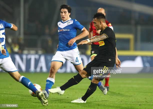 Lautaro Martinez of FC Internazionale scores the opening goal during the Serie A match between Brescia Calcio and FC Internazionale at Stadio Mario...