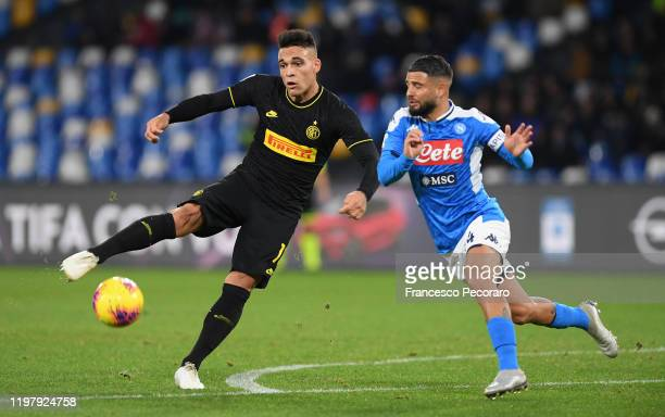 Lautaro Martinez of FC Internazionale vies with Lorenzo Insigne of SSC Napoli during the Serie A match between SSC Napoli and FC Internazionale at...