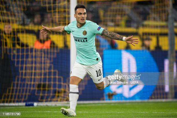 Lautaro Martinez of Inter celebrates after scoring his team's first goal during the UEFA Champions League group F match between Borussia Dortmund and...