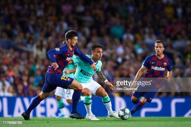 Lautaro Martinez of Inter competes for the ball with Clement Lenglet of FC Barcelona during the UEFA Champions League group F match between FC...
