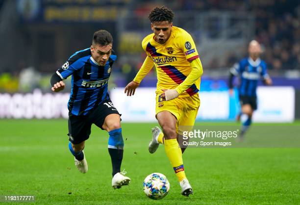 Lautaro Martinez of Inter competes for the ball with Jean-Clair Todibo of Barcelona during the UEFA Champions League group F match between Inter and...
