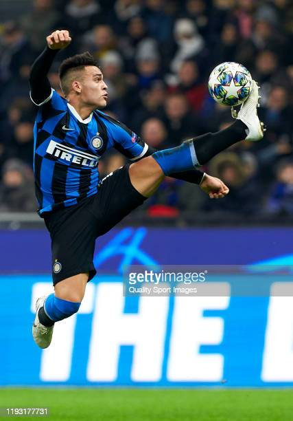 Lautaro Martinez of Inter controls the ball during the UEFA Champions League group F match between Inter and FC Barcelona at Giuseppe Meazza Stadium...