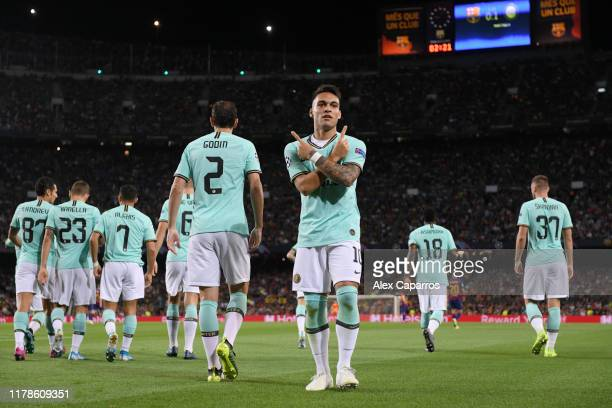 Lautaro Martinez of Inter Milan celebrates after he scores his sides first goal during the UEFA Champions League group F match between FC Barcelona...