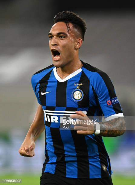 Lautaro Martinez of Inter Milan celebrates after scoring his team's first goal during the UEFA Europa League Semi Final between Internazionale and...