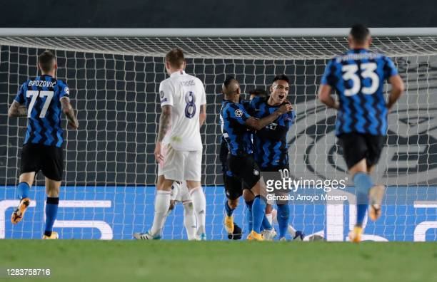 Lautaro Martinez of Inter Milan celebrates his sides second goal scored by Ivan Perisic during the UEFA Champions League Group B stage match between...