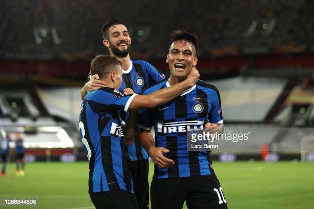 Lautaro Martinez of Inter Milan celebrates with his team mates after scoring his team's third goal during the UEFA Europa League Semi Final between...