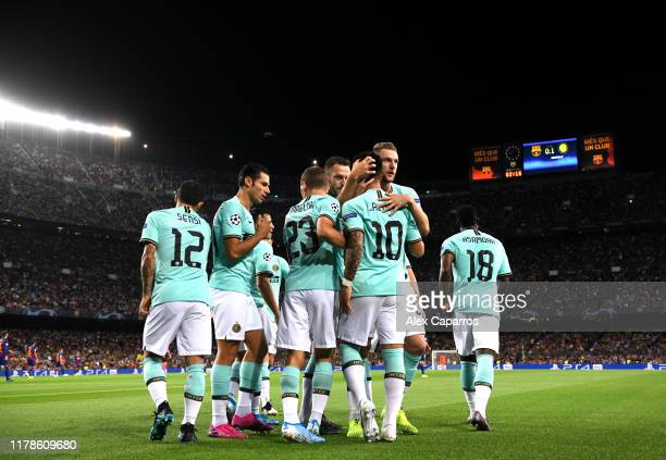 Lautaro Martinez of Inter Milan celebrates with team mates after he scores his sides first goal during the UEFA Champions League group F match...