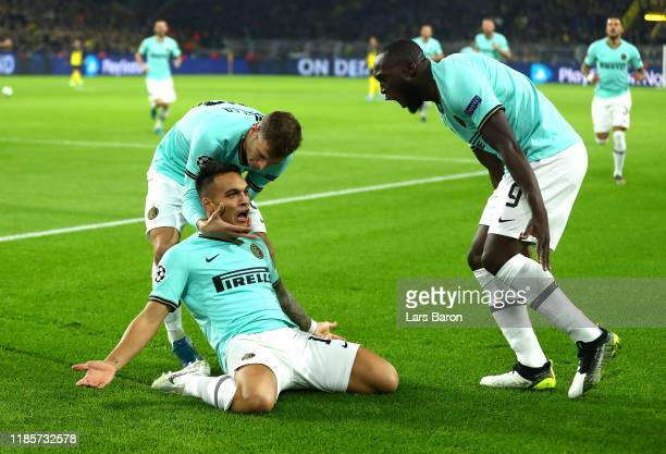 Lautaro Martinez of Inter Milan celebrates with teammates after scoring his team's first goal during the UEFA Champions League group F match between...