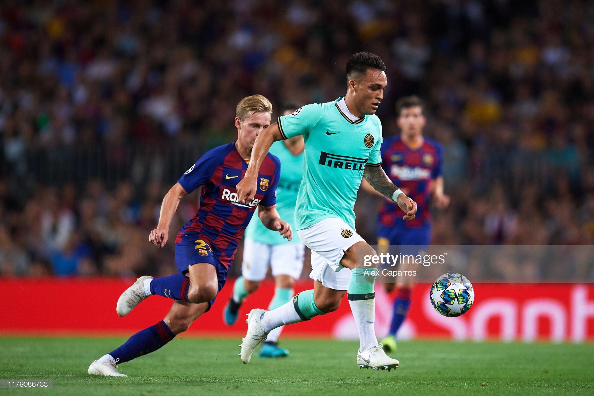 صور مباراة : برشلونة - إنتر 2-1 ( 02-10-2019 )  Lautaro-martinez-of-inter-runs-with-the-ball-followed-by-frenkie-de-picture-id1179086733?s=2048x2048