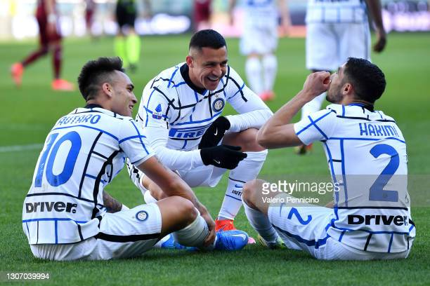 Lautaro Martinez of Internazionale celebrates with team mates Alexis Sanchez and Achraf Hakimi after scoring their side's second goal during the...