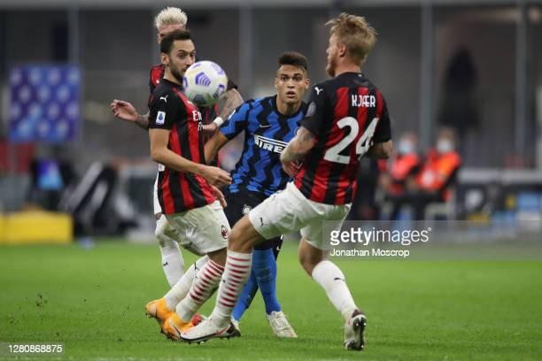 Lautaro Martinez of Internazionale fires a shot between Samuel Castillejo Hakan Calhanoglu and Simon Kjaer of AC Milan during the Serie A match...