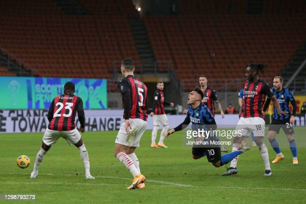 Lautaro Martinez of Internazionale is fouled on the edge of the area by Soualiho Meite of AC Milan resutling in the free kick from which Christian...