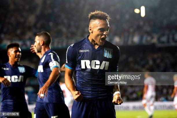 Lautaro Martinez of Racing Club celebrates after scoring the first goal of his team during a match between Racing Club and Huracan as part of...