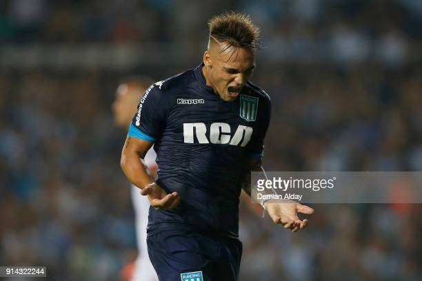 Lautaro Martinez of Racing Club celebrates after scoring the third goal of his team during a match between Racing Club and Huracan as part of...