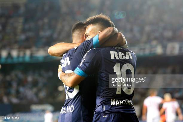 Lautaro Martinez of Racing Club celebrates with teammate Federico Zaracho after scoring the first goal of his team during a match between Racing Club...