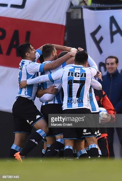 Lautaro Martinez of Racing Club celebrates with teammates after scoring the first goal of his team during a match between River Plate and Racing Club...